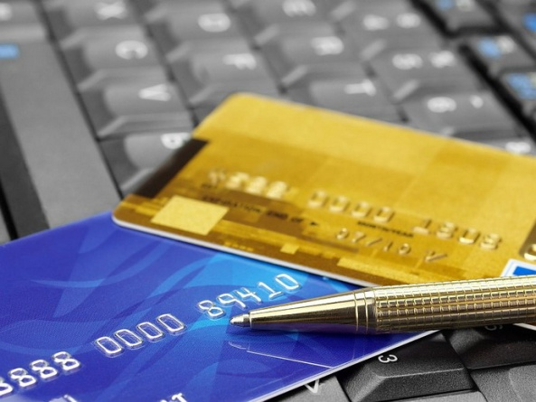 Closeup of credit cards and pen on computer keyboard